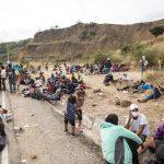 Al menos 21 migrantes hondureños que viajan en caravana por Guatemala rumbo a Estados Unidos han dado positivo a una prueba de COVID-19; esto según confirmaron las autoridades sanitarias locales.