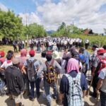 Los enfrentamientos entre comunitarios y policías en El Estor, Izabal, dejó un saldo de 19 personas heridas; con base en estos hechos el Gobierno del presidente Alejandro Giammattei decretó un estado de sitio y toque de queda.